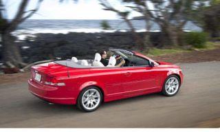 Tire, Wheel, Mode of transport, Automotive design, Vehicle, Road, Red, Car, Automotive mirror, Vehicle door,