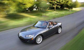 Mode of transport, Automotive mirror, Road, Automotive design, Nature, Vehicle, Land vehicle, Automotive parking light, Asphalt, Transport,