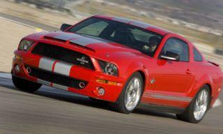 Tire, Mode of transport, Automotive design, Vehicle, Transport, Land vehicle, Hood, Infrastructure, Car, Red,