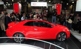 Tire, Wheel, Automotive design, People, Vehicle, Event, Transport, Car, Alloy wheel, Red,