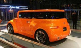 Motor vehicle, Mode of transport, Automotive design, Transport, Yellow, Automotive exterior, Vehicle, Property, Orange, Vehicle door,