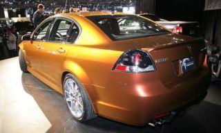 Motor vehicle, Tire, Mode of transport, Automotive design, Vehicle, Yellow, Land vehicle, Car, Rim, Alloy wheel,