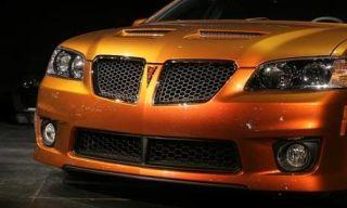 Motor vehicle, Mode of transport, Yellow, Hood, Transport, Headlamp, Automotive design, Vehicle, Grille, Automotive lighting,