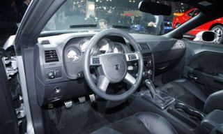 Motor vehicle, Automotive mirror, Mode of transport, Steering part, Vehicle, Steering wheel, Transport, Car, White, Center console,