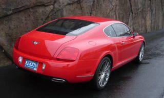 Automotive design, Vehicle, Red, Car, Vehicle registration plate, Photograph, White, Fender, Automotive lighting, Beauty,