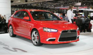 Tire, Wheel, Automotive design, Vehicle, Product, Land vehicle, Event, Car, Grille, Red,