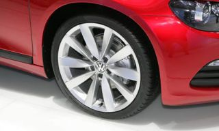 Tire, Wheel, Automotive tire, Alloy wheel, Automotive wheel system, Vehicle, Rim, Spoke, Red, Automotive lighting,