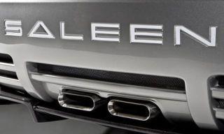 Motor vehicle, Automotive design, Automotive exterior, Grille, White, Logo, Black, Bumper, Grey, Metal,