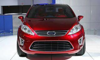 Motor vehicle, Tire, Mode of transport, Automotive mirror, Automotive design, Daytime, Vehicle registration plate, Automotive exterior, Vehicle, Product,
