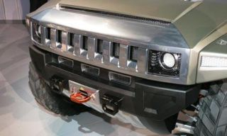 Motor vehicle, Product, Automotive exterior, Automotive design, Automotive lighting, Headlamp, Hood, Grille, Property, Photograph,