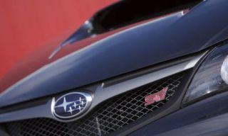 Motor vehicle, Mode of transport, Automotive design, Grille, Car, Logo, Light, Automotive lighting, Luxury vehicle, Hood,