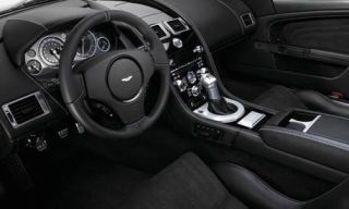 Motor vehicle, Mode of transport, Steering part, Automotive design, Steering wheel, Transport, Photograph, White, Speedometer, Center console,