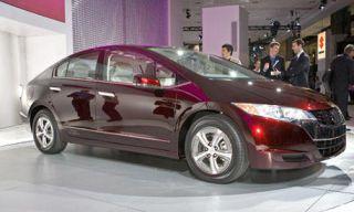 Mode of transport, Automotive design, Vehicle, Transport, Car, Red, Alloy wheel, Fender, Vehicle door, Rim,