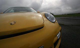 Motor vehicle, Mode of transport, Automotive mirror, Automotive design, Yellow, Vehicle, Automotive exterior, Hood, Car, Automotive lighting,