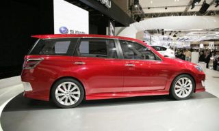Automotive design, Mode of transport, Vehicle, Transport, Car, Rim, Alloy wheel, Red, Automotive exterior, Automotive lighting,