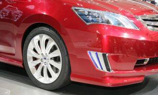 Motor vehicle, Wheel, Tire, Automotive design, Vehicle, Alloy wheel, Red, Rim, Automotive tire, Automotive lighting,