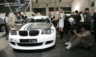 People, Event, Automotive design, Social group, Grille, Photograph, Car, Vehicle registration plate, Personal luxury car, Luxury vehicle,