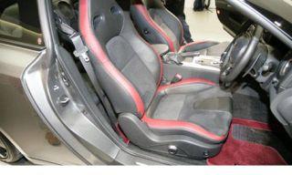 Motor vehicle, Mode of transport, Automotive design, Steering part, White, Red, Car seat, Steering wheel, Luxury vehicle, Personal luxury car,