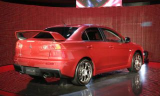 Tire, Wheel, Mode of transport, Automotive design, Vehicle, Car, Alloy wheel, Rim, Red, Full-size car,