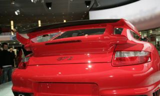Automotive design, Automotive tail & brake light, Vehicle, Automotive exterior, Red, Car, Automotive lighting, Performance car, Vehicle registration plate, Fender,