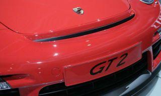 Red, Automotive exterior, Bumper, Automotive tail & brake light, City car, Coquelicot, Symbol,