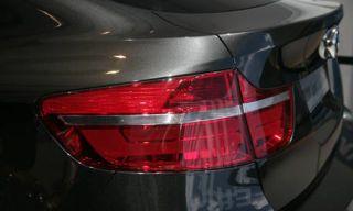 Automotive tail & brake light, Automotive design, Automotive lighting, Red, Automotive exterior, White, Car, Light, Trunk, Luxury vehicle,