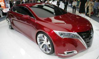 Mode of transport, Automotive design, Vehicle, Transport, Event, Land vehicle, Car, Red, Concept car, Automotive mirror,