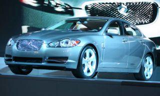 Tire, Motor vehicle, Automotive mirror, Wheel, Mode of transport, Automotive design, Product, Vehicle, Automotive lighting, Land vehicle,