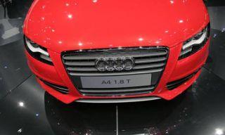 Motor vehicle, Mode of transport, Automotive design, Vehicle, Grille, Red, Automotive exterior, White, Automotive lighting, Light,