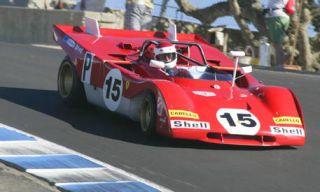 Mode of transport, Automotive design, Photograph, White, Red, Asphalt, Race track, Automotive exterior, Racing, Motorsport,