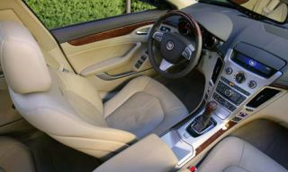 Motor vehicle, Mode of transport, Steering part, Transport, Steering wheel, Car, White, Automotive mirror, Center console, Car seat,