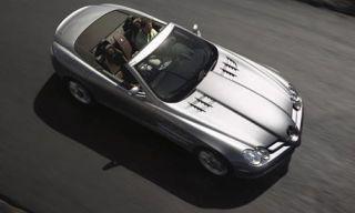 Motor vehicle, Mode of transport, Automotive design, Automotive mirror, Automotive exterior, Toy, Vehicle door, Automotive lighting, Transport, Photograph,