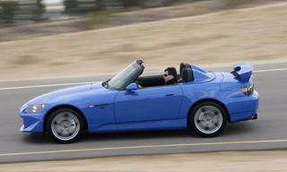 Tire, Wheel, Mode of transport, Automotive design, Vehicle, Infrastructure, Photograph, Car, Alloy wheel, Automotive wheel system,