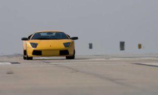Motor vehicle, Mode of transport, Automotive design, Road, Automotive exterior, Transport, Yellow, Vehicle, Automotive lighting, Infrastructure,