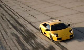 Motor vehicle, Mode of transport, Automotive design, Transport, Vehicle, Yellow, Automotive exterior, Automotive tire, Land vehicle, Automotive lighting,