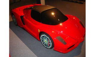 Motor vehicle, Mode of transport, Automotive design, Vehicle, Land vehicle, Red, Automotive exterior, Car, Automotive lighting, Concept car,