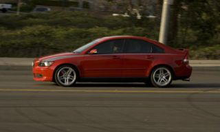 Tire, Wheel, Mode of transport, Vehicle, Automotive design, Alloy wheel, Rim, Car, Road, Red,