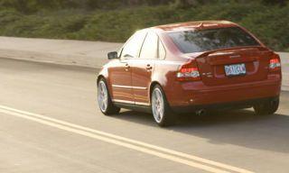 Tire, Motor vehicle, Road, Mode of transport, Automotive design, Automotive tail & brake light, Vehicle, Infrastructure, Vehicle registration plate, Car,