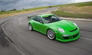 Tire, Wheel, Automotive design, Vehicle, Road, Green, Land vehicle, Infrastructure, Rim, Car,