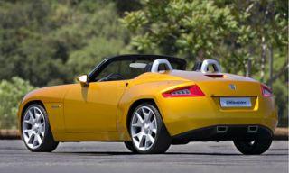 Tire, Wheel, Mode of transport, Automotive design, Vehicle, Yellow, Transport, Land vehicle, Infrastructure, Car,