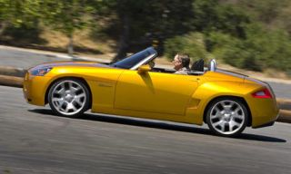Tire, Wheel, Mode of transport, Automotive design, Transport, Road, Yellow, Vehicle, Infrastructure, Asphalt,