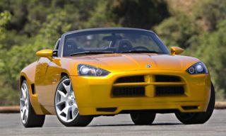 Automotive design, Mode of transport, Automotive mirror, Vehicle, Yellow, Transport, Hood, Road, Land vehicle, Car,