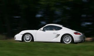 Wheel, Tire, Automotive design, Vehicle, Automotive lighting, Rim, Alloy wheel, Photograph, White, Car,