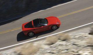 Motor vehicle, Road, Automotive mirror, Mode of transport, Automotive design, Transport, Road surface, Asphalt, Automotive tire, Infrastructure,