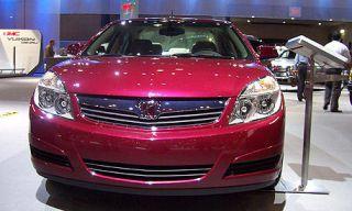 Automotive design, Vehicle, Daytime, Event, Automotive lighting, Car, Automotive mirror, Grille, Technology, Bumper,