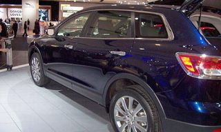 Tire, Motor vehicle, Wheel, Automotive design, Vehicle, Product, Land vehicle, Alloy wheel, Event, Automotive tire,