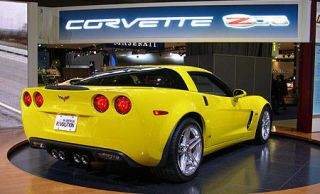 Tire, Motor vehicle, Wheel, Mode of transport, Automotive design, Yellow, Transport, Vehicle, Automotive lighting, Land vehicle,