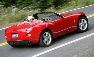 Tire, Wheel, Motor vehicle, Mode of transport, Automotive design, Vehicle, Infrastructure, Road, Red, Performance car,