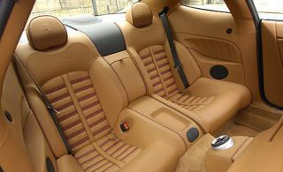 Motor vehicle, Mode of transport, Brown, Vehicle, Transport, Car seat, White, Vehicle door, Car seat cover, Head restraint,