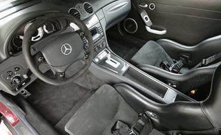 Motor vehicle, Mode of transport, Steering part, Steering wheel, Automotive design, White, Center console, Personal luxury car, Car seat, Luxury vehicle,
